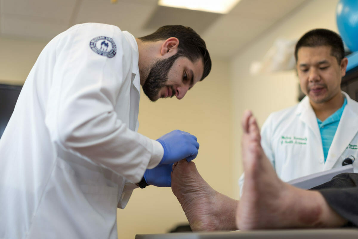 Doctor examines patient's foot