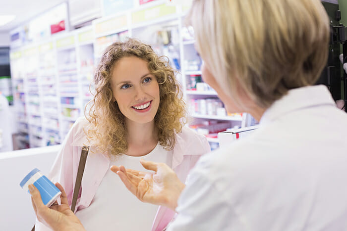 Pharmacist and her customer talking about medication in the pharmacy